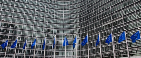 European flags in front of the Berlaymont building, headquarters of the European commission in Brussels. Stock Photo