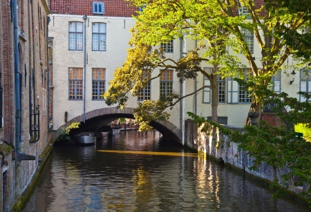 Classic view of channels of Bruges. Belgium. Medieval fairytale city. Summer urban landscape.  photo