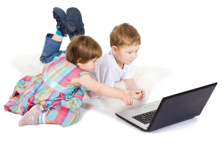 12 18 months: brother and the sister look cartoon films on a laptop Stock Photo