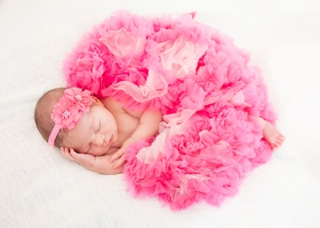 sleeping  newborn baby (at the age of 14 days) photo