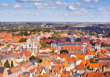 Panorama of the central part of Bruges. Top view on the background of the red roofs of the city. Belgium photo