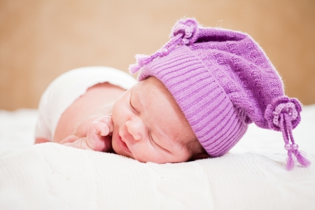 newborn baby (at the age of 14 days) sleeps in a knitted  hat Stock Photo - 16830206