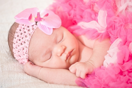 sleeping  newborn baby  at the age of 14 days  photo