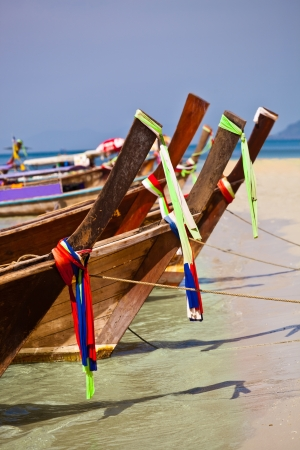 longtail boats on a tropical island near phuket, thailand Stock Photo - 18573220