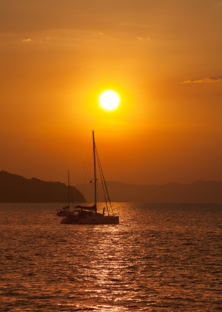 Sailing yacht illuminated by the light of the sun setting Stock Photo - 18573228