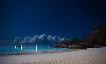 Night on a tropical island  Cruise boats are near the shore  photo