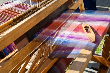 fabricating: Old weaving loom and shuttle