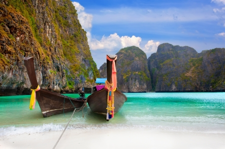Phi Phi Island - Traditional longtail boat in Loh Dalum Bay, Thailand photo