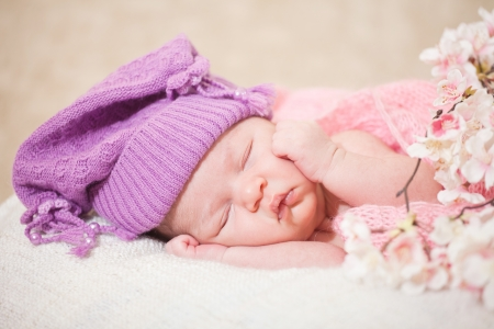 newborn baby  at the age of 14 days  sleeps in a knitted  hat Stock Photo