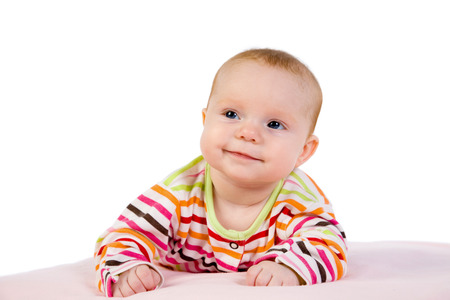 Portrait of the baby on a light background photo