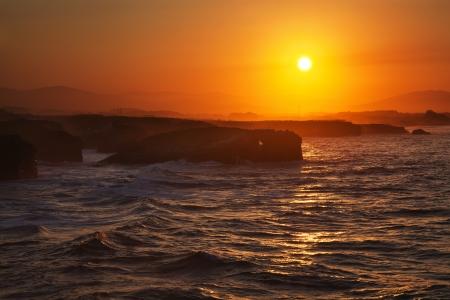 inflow: Storming waves during inflow at sunset on Playa de las Catedrales, Spai