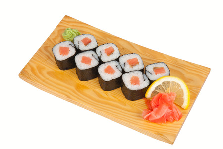 Eight sushi rolls with smoked salmon on board isolated on white photo
