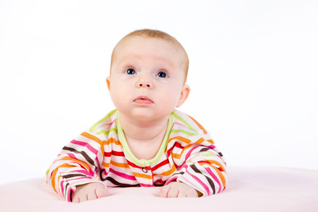 Portrait of the baby on a light  photo