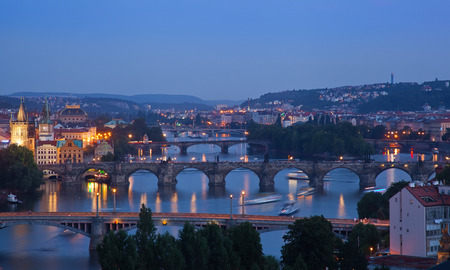 Beautiful evening view of Prague's center part with bridges above Vltava river, sunset, Czech Republic photo