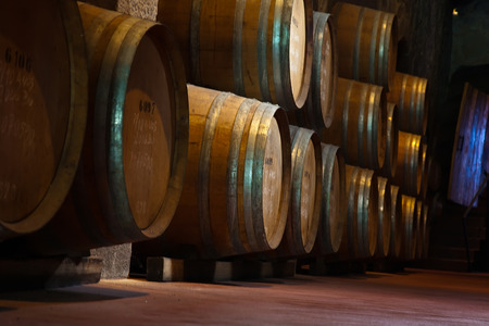 wooden barrels hold Port fortified wine to mature in wine cellars