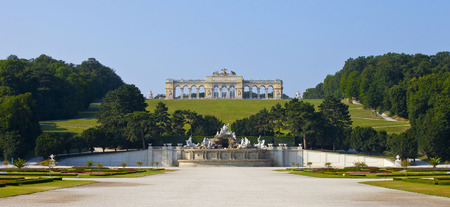 the gloriette:  View on Gloriette structure and Neptune fountain in Schonbrunn Palace, Vienna, Austria