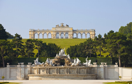 the gloriette: View on Gloriette structure and Neptune fountain in Schonbrunn Palace, Vienna, Austria   Editorial