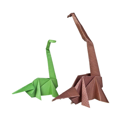 Origami. Paper figures of dinosaurs. Traditional Japanese art folding of figures from paper photo