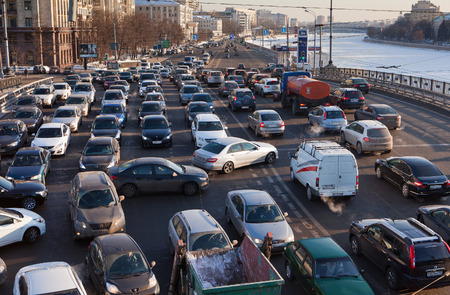 Road jams arise because of a large number of transport which exceeds the maximum capacity of roads in the city