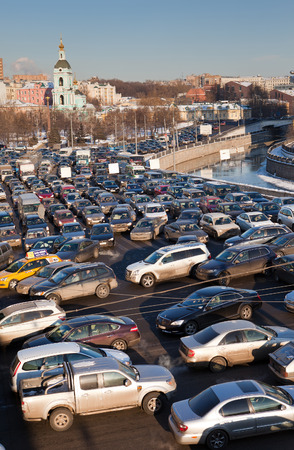 arise: MOSCOW,RUSSIA - - FEBRUARY 8, 2012: Big transport stopper. Road jams arise because of a large number of transport which exceeds the maximum capacity of roads in the city