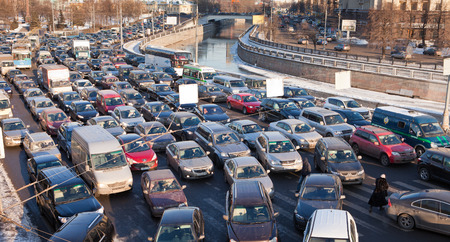 exceeds: MOSCOW,RUSSIA - - FEBRUARY 8, 2012: Big transport stopper. Road jams arise because of a large number of transport which exceeds the maximum capacity of roads in the city