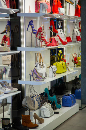 showwindow: ITALY, MILAN - MAY 07, 2014: Magnificent womens shoes in a shop show-window. The city of Milan is the recognized capital of the European fashion