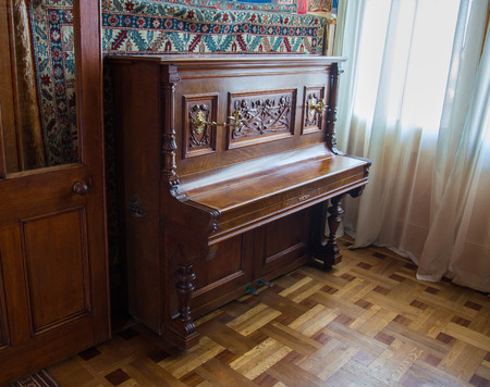 vorontsov: CRIMEA, RUSSIA - SEPTEMBER 25, 2014: An old piano in Vorontsov Palace in Alupka. The palace is built in 1848. Editorial