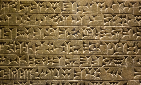 Close-up of ancient clay tablet with cuneiform writings Imagens