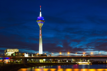 Dusseldorf - Germany. night scene includes media tower and bridge on Rhine river Stock Photo