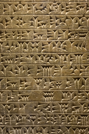 Close-up of ancient clay tablet with cuneiform writings