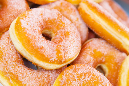 donuts strewed with icing sugar close up
