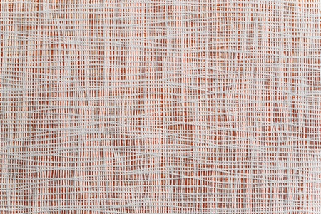 paper textures: thin white strips closely spaced on a bright red background. Texture, background