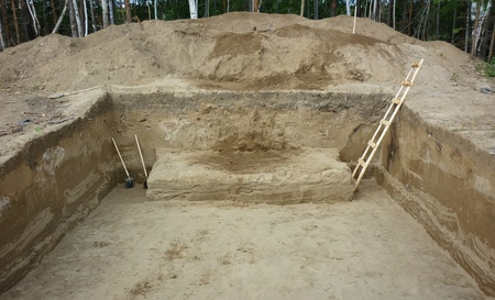 A deep hole dug during archaeological excavations, view from below. 2011