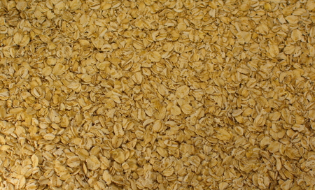 mouthwatering: background of bright mouth-watering fresh rolled oats to make porridge