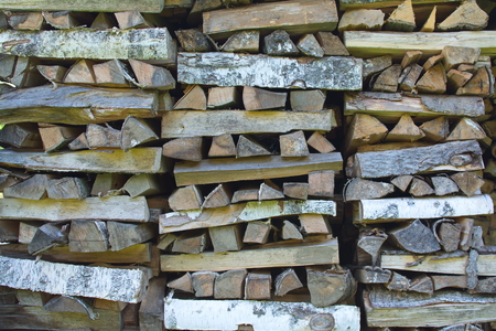 nicely: large nicely stacked pile of firewood close up