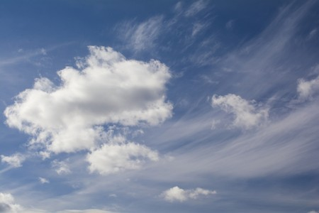 cumulus: fluffy white cumulus clouds against the blue calm sky