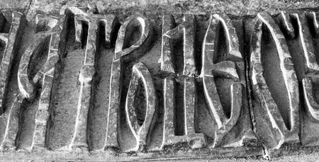 old church: bronze Trinity inscription in old Church Slavonic