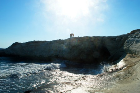 couple in love on the high seashore in backlight sunlight