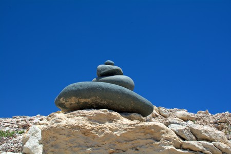 pyramid of the stones against the bright blue sky Stock Photo