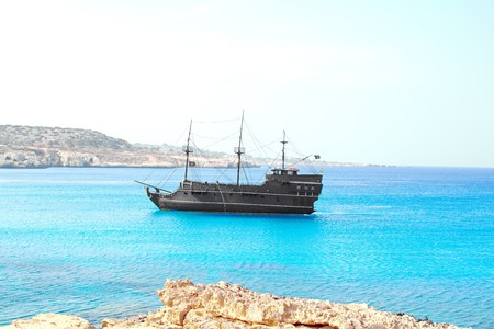 pirate sailing ship on the background of bright blue sea and sky Stock Photo