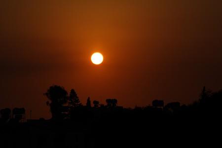 surreal south city skyline against the setting sun Stock Photo