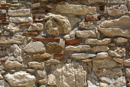 background of ancient wall made of blocks of sandstone