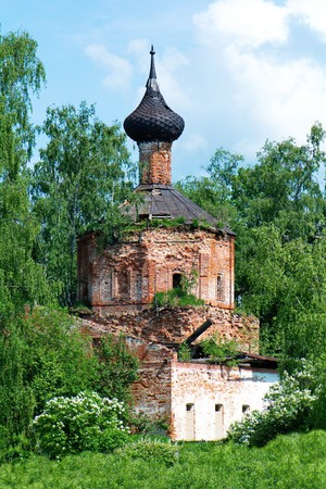 the old Orthodox Church on a background of green trees