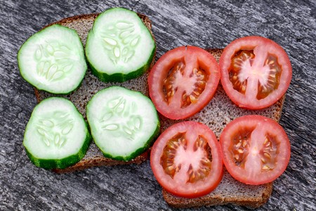 big sandwiches with tomato and cucumber on a colorful background