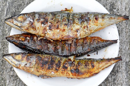 three fishes smoked over the coals