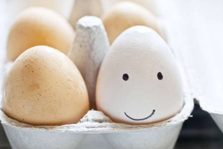 carton: Smiley face egg in a carton