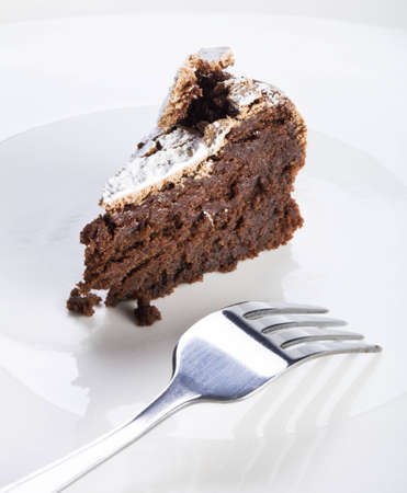 flourless chocolate cake: Slice of flourless chocolate cake with fork