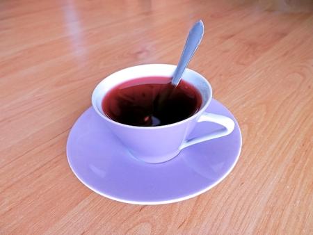 ローズヒップ ティー磁器容器で飲む軽食と写真イメージのために準備 写真素材