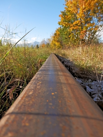 slantwise: The rail in the detailed photo shows autumn direction hiking the mountains.