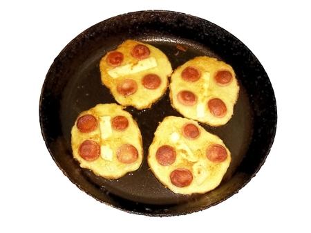 distinctive flavor: Food preparation of potato dough sausage and cheese added garlic and distinctive flavor Stock Photo